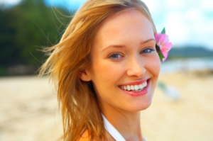 Fashion shot of beautiful blonde woman on the beach in Hawaii