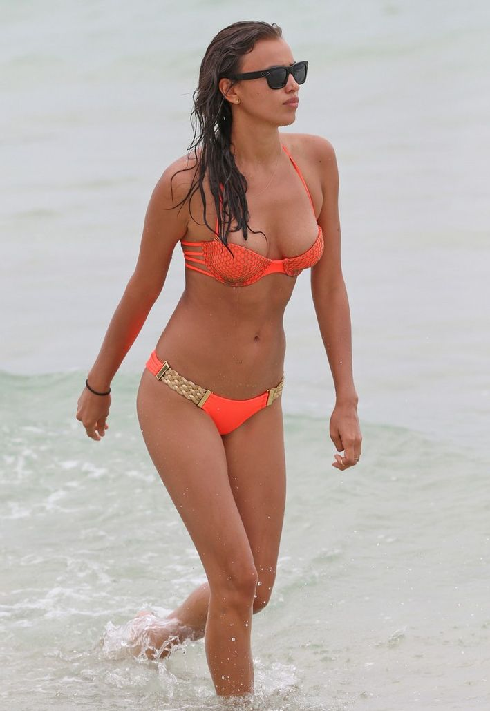 Supermodel Irina Shayk stuns in an orange bikini as she takes a dip in the ocean on Miami Beach